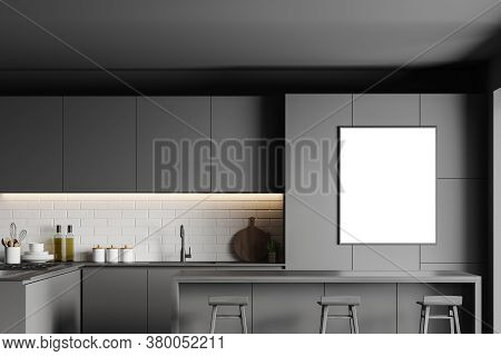 Interior Of Stylish Kitchen With Gray And Brick Walls, Gray Cupboards And Bar With Stools. Vertical