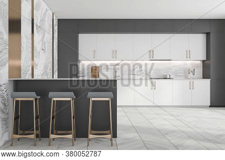 Interior Of Stylish Kitchen With Gray And Marble Walls, White Cupboards And Countertops And Bar With