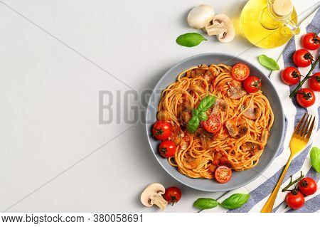 Traditional Italian Cuisine. Plate With Spaghetti, Tomato Sauce, Cherry Tomatoes, Mushrooms And Basi