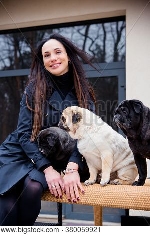 Nice Woman With Cute Pug Dog At Home. Pet Adoption, Life Of Pets. Female Carrying A Pug, Animals Hea