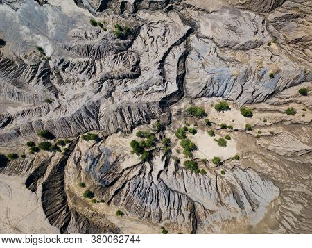 Fancy And Unusual Aerial Landscape Of Romantsev Mountains Wih Blue Lakes And Mud Erosion Looks Like