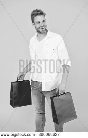 Handsome Attractive Man Smiling While Shopping. Real Shopaholic. Buy Gifts And Presents Online. Guy