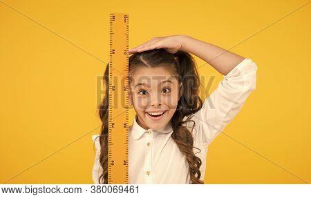 I Am Still Growing. Tall Kid. Kid School Uniform Hold Ruler. Pupil Cute Girl With Big Ruler. Geometr