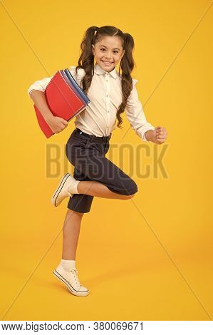 Active Child In Motion. Beginning School Lesson. Keep Going. Active Kid. Hurry Up. Girl With Books O