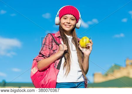 Enjoy The Taste Of Eating Right. Happy Kid Hold Apple Sunny Outdoors. Fruit Snack. Healthy Eating Ha