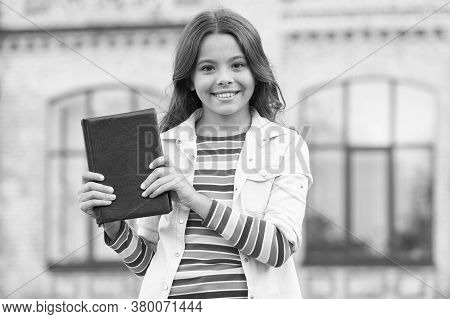 Smart Literature Exercises Your Mind. Happy Child Hold Book Outdoors. Literature Education. Literatu