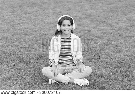Yoga Girl. Small Kid In Headphones. Summer Playlist. Enjoy Spring Nature Outdoor. Child Study Audio