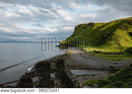 Scottish Landscape With Hills And Shoreline Near Staffin At Isle Of Skye With Ruins Of Old Diatomite