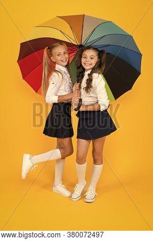 Rainy Day. Happy Childhood. School Time. Rainbow Umbrella. Colorful Life. Schoolgirls Happy Big Umbr