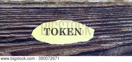 Business And Finance Concept. View Of Piece Of Paper Written Word Token On Wooden Background,