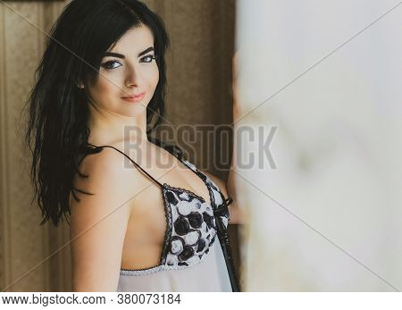 Cozy Home Concept. Sexy Lady In Erotic Lingerie, Pastel And Wood Interior. Woman With Romantic Mood.