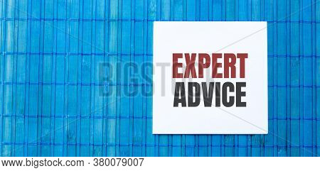 Blank Note Pad With Expert Advice Text On Green Wooden Background