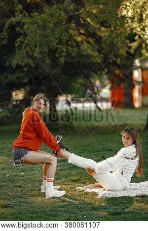 Girls Spend Time In A Summer Park