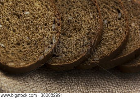 Rye Bread With Sliced Seeds, Burlap, Background