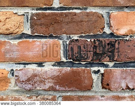 Vintage Close-up View Old Textured Red Black Brick Wall, Rich Colors And Shadows Suitable For Websit