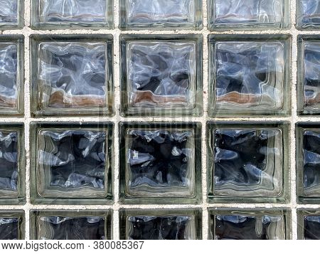 Vintage Close-up View Wavy Texture Glass Brick Window Wall, Faded White Grout Looking Down Suitable