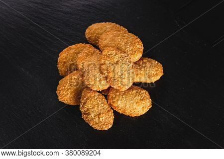 Chicken Fried Nuggets On A Dark Background. Fast Food Concept