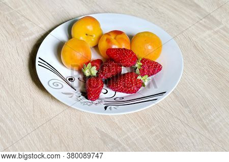 Group Of Fresh Ripe Apricots And Strawberry  In Plate,  Ready To Eat, Sofia, Bulgaria