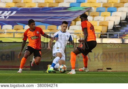 Kyiv, Ukraine - July 4, 2020: Nazarii Rusyn Of Fc Dynamo Kyiv (c) Fights For A Ball With Dodo (l) An