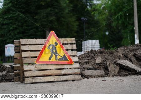 Sign Of Road Work To Inform Traffic Participants About Carrying Out Repairs On Road. Concept Of Care