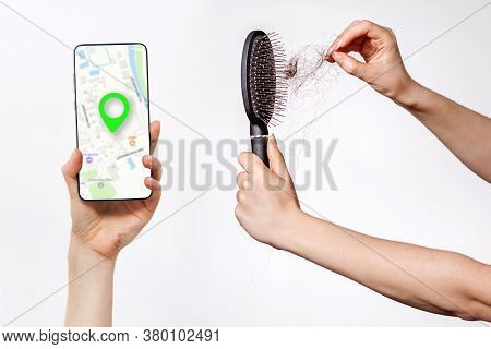 Females Hands Clean The Comb From Fallen Hair, And Holds A Smartphone With An Online Maps App. White