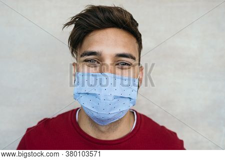 Young Man Wearing Face Mask Portrait - Latin Boy Using Protective Facemask For Preventing Spread Of
