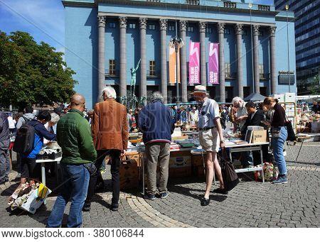 Stockholm, Sweden - Jul 07, 2019: People on flea market at Hotorget square in front of Concert Hall in central Stockholm