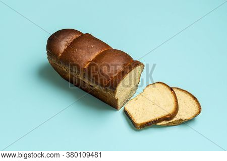 Sliced Bread Isolated On A Blue Colored Background. Hokkaido Sandwich Bread Home-baked With No Yeast