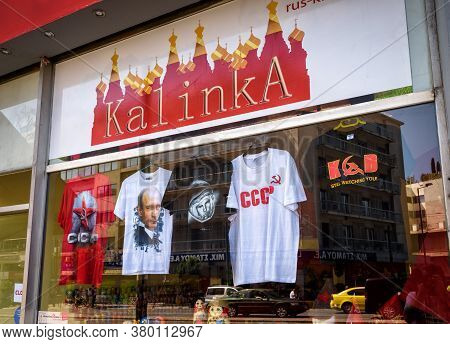 Athens - May 9, 2018: Gift Shop Near Plaka District In Athens, Greece. Clothes With Russian And Sovi