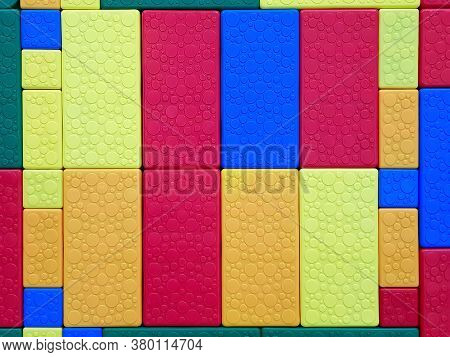 Pattern Of The Colorful Plastic Blocks From The Children's Designer. Background For Design And Decor
