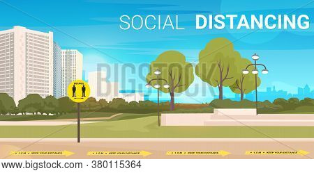 City Street With Signs For Social Distancing Yellow Stickers Coronavirus Epidemic Protection Measure
