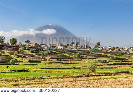 Dormant Misti Volcano Over The Fields And Houses Of Peruvian City Of Arequipa, Peru