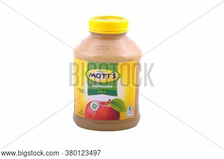 A Large Jar Of Motts Applesauce Isolated On White