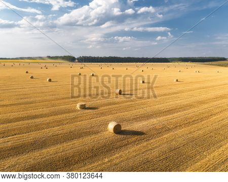Aerial View Of Hay Bales At Sunset In Summer. Top View Of Hay Stacks. Agriculture. Field After Harve