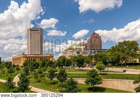 Cityscape Of Columbus, Ohio, Above The Scioto River From Battelle Riverfront Park