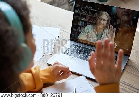 Hispanic Teen Girl School College Student Distance Learning Waving Hand Studying With Online Teacher