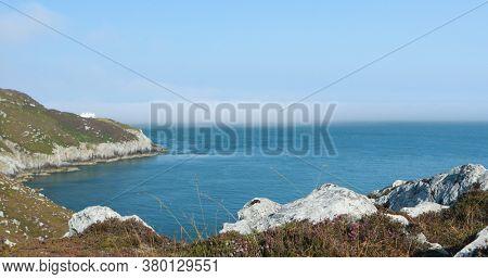 Holy Iland coast line on sunny day. Wales UK