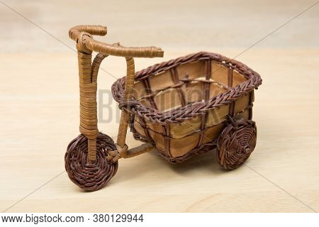 Toy Wood Tricycle On A Wooden Background