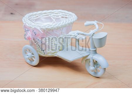 Toy White Tricycle On A White Background