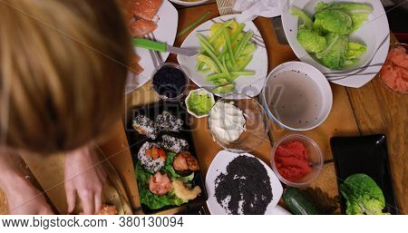 Timelapse of preparing sushi in home, top view on table.
