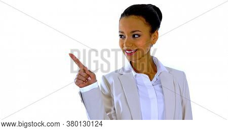 Cute happy smiling mixed race business woman points a finger away over white background.