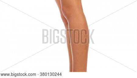 Woman's long sexy legs seeing in front, side and back view. Woman turns around to show every side of her legs. Camera goes upper to show sexy bottom. Isolated on white.