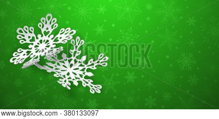 Christmas Background With Two Curved Paper Snowflakes With Soft Shadows On Green Background