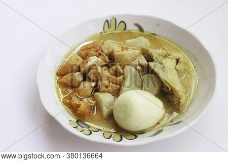Lontong Sayur Or Ketupat, Indonesian Cuisine. Compressed Rice Cake Or Lontong With Vegetables Cooked