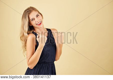 Portrait Of Happy Excited Young Woman With Red Lips Looking At Camera And Celebrating Success