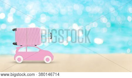 Summertime Vacation Concept. Pink Toy Car With Big Pink Suitcase On A Roof Creative Travel Concept.