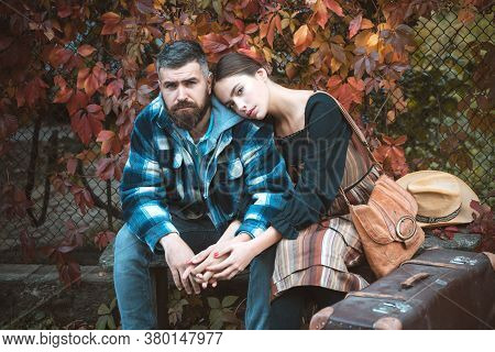 Dreamy Romantic Couple Of Lovers Holding Hands At Burgundy Ivy Wall Background. Handsome Bearded Man