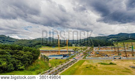 Aerial View Of Construction Site Under Ominous Clouds