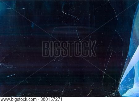 Broken Window Glass. Fractured Texture. Blue Purple Damaged Surface With Smeared Dirt Dust Scratches