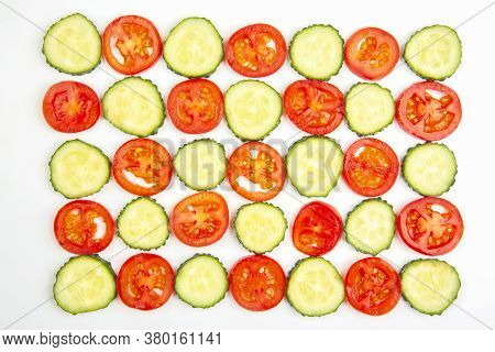 Sliced pieces Of Cucumber And Tomato On A White Background. Fast Food And Breakfast
